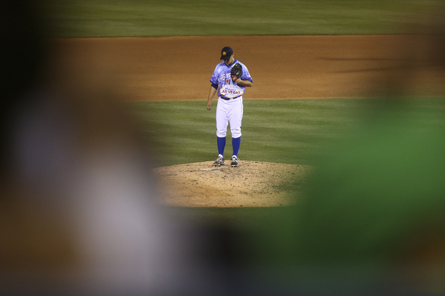 Las Vegas 51s player Paul Sewald pauses on the mound before pitching against the El Paso Chihuahuas at Cashman Field in Las Vegas on Friday, May 13, 2016. (Chase Stevens/Las Vegas Review-Journal F ...