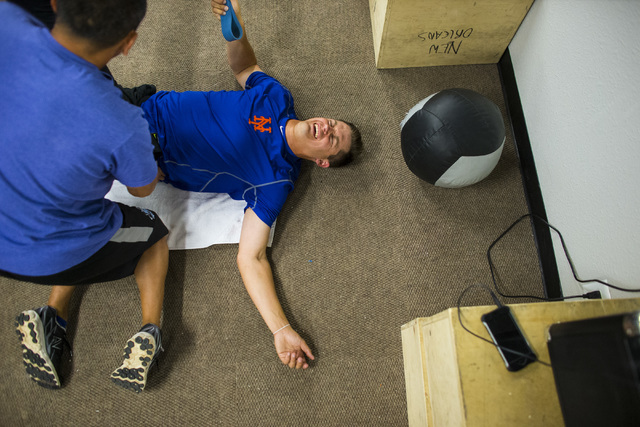 Las Vegas 51s player Paul Sewald works out with the help of strength and conditioning coach Jon Cioffi ahead of a game against the El Paso Chihuahuas at Cashman Field in Las Vegas on Friday, May 1 ...