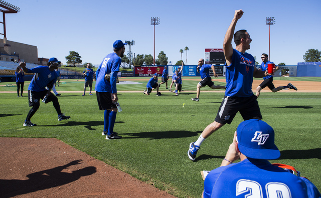 Las Vegas 51s players cheer on teammates Josh Edgin and Zach Thornton, upper right, as they compete in a 100-yard-dash ahead of a game against the El Paso Chihuahuas at Cashman Field in Las Vegas  ...