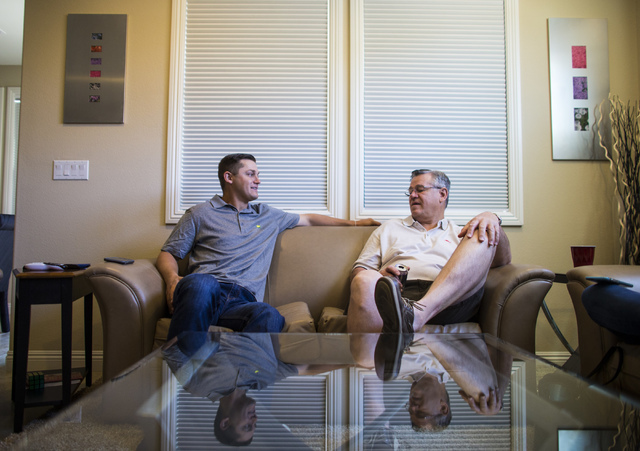 Las Vegas 51s player Paul Sewald talks with his dad, Mark, while watching golf at their home in the Summerlin area of Las Vegas on Friday, May 13, 2016. (Chase Stevens/Las Vegas Review-Journal Fol ...