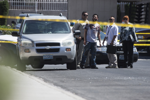 The scene of a shooting near Tonopah Drive and Washington Avenue is seen on Wednesday, June 1, 2016, in Las Vegas. Erik Verduzco/Las Vegas Review-Journal Follow @Erik_Verduzco