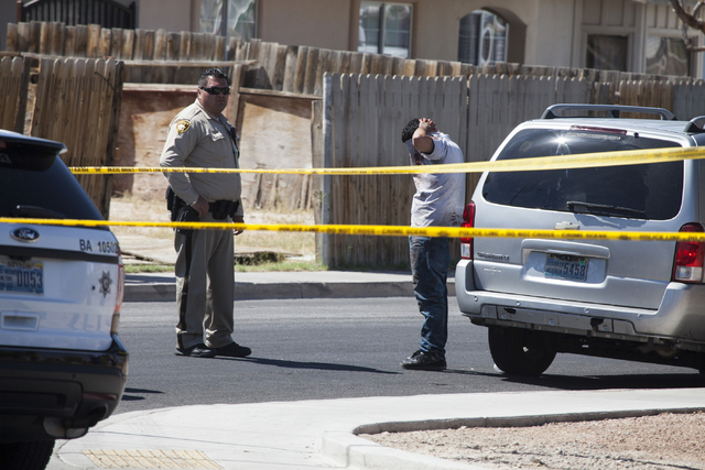 The scene of a shooting near Tonopah Drive and Washington Avenue is seen on Wednesday, June 1, 2016, in Las Vegas. Loren Townsley/Las Vegas Review-Journal Follow @lorentownsley