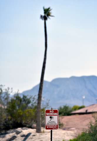 """One of many """"no trespassing"""" signs is seen posted along access points to the closed Silverstone golf course Monday, May 23, 2016, in Las Vegas. (David Becker/Las Vegas Review-Journal) Follow @davi ..."""