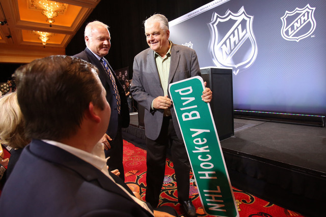 Commissioner Steve Sisolak with an NHL Hockey Blvd street sign on June 22, 2016. (Jeff Scheid/Las Vegas Review-Journal)