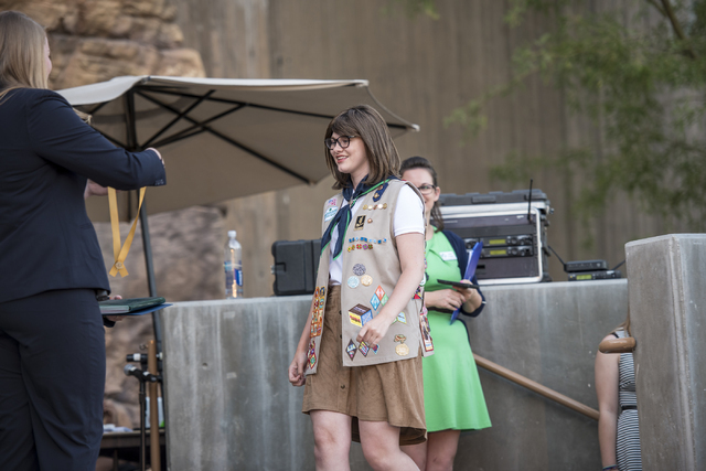 Veronica Beauchamp walks across the stage to accept her Gold Award from the Girl Scouts of America during the Girl Scout High Awards Banquet at the Springs Preserve in Las Vegas on Thursday, May 2 ...