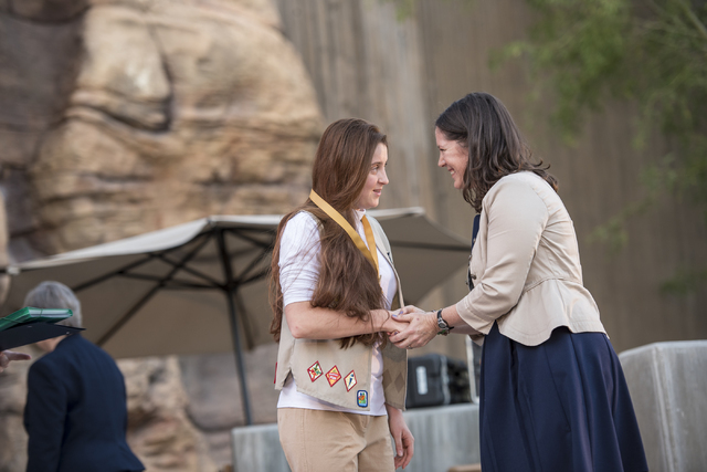 Ilonna Biondo, left, shakes hands with Liz Ortenburger, CEO of the Girl Scouts of Southern Nevada, after accepting her Gold Award from the Girl Scouts of America during the Girl Scout High Awards  ...
