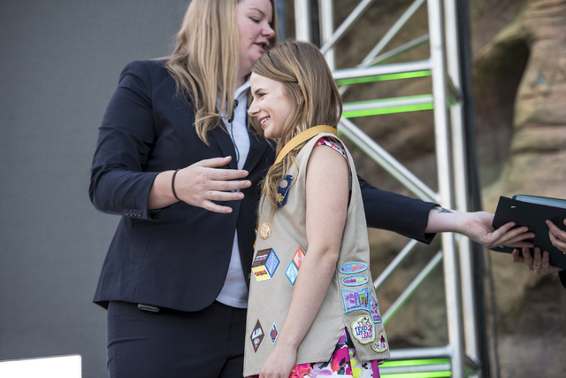 Sarah Bullock walks across the stage to accept her Gold Award from the Girl Scouts of America during the Girl Scout High Awards Banquet at the Springs Preserve in Las Vegas on Thursday, May 26, 20 ...