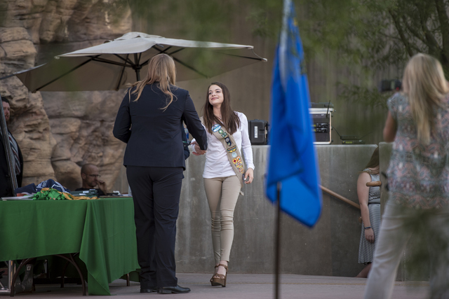 Stephanie Mevius walks across the stage to accept her Gold Award from the Girl Scouts of America during the Girl Scout High Awards Banquet at the Springs Preserve in Las Vegas May 26, 2016. Joshua ...