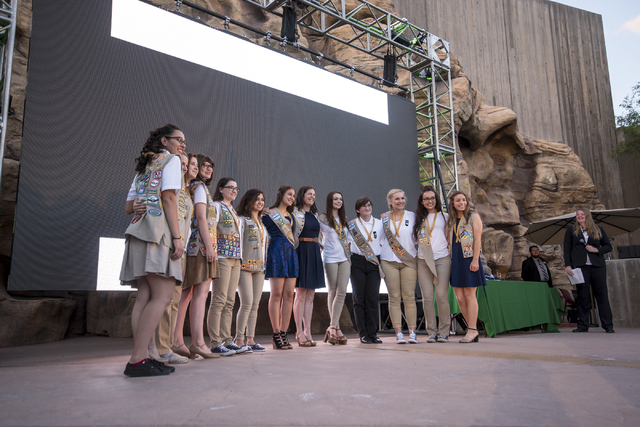 Winners of the Gold Award from the Girl Scouts of America pose for a photo with Liz Ortenburger, CEO of the Girl Scouts of Southern Nevada, on stage during the Girl Scout High Awards Banquet at th ...