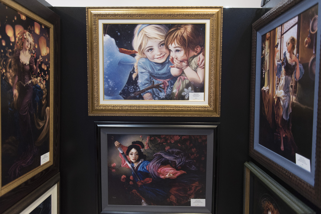 Limited edition prints of paintings by Heather Theurer hang in Magical Memories featuring Disney Fine Art at Town Square Las Vegas May 23, 2016. Jason Ogulnik/View