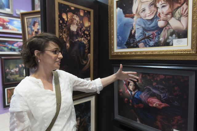 Summerlin artist Heather Theurer gives a tour of her work, explaining her creative process, at Magical Memories featuring Disney Fine Art at Town Square Las Vegas May 23, 2016. Jason Ogulnik/View