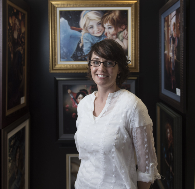Artist Heather Theurer poses with her work in Magical Memories featuring Disney Fine Art at Town Square Las Vegas May 23, 2016. Jason Ogulnik/View