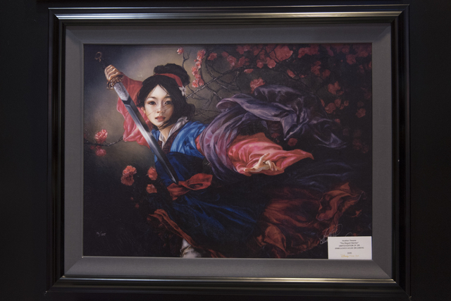 A limited-edition print of a painting by Heather Theurer hangs in Magical Memories featuring Disney Fine Art at Town Square Las Vegas May 23, 2016. Jason Ogulnik/View