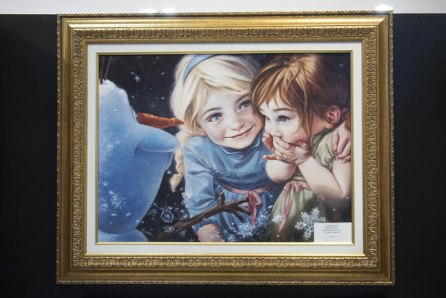 A limited edition print of a painting by Heather Theurer hangs in Magical Memories featuring Disney Fine Art at Town Square Las Vegas May 23, 2016. Jason Ogulnik/View