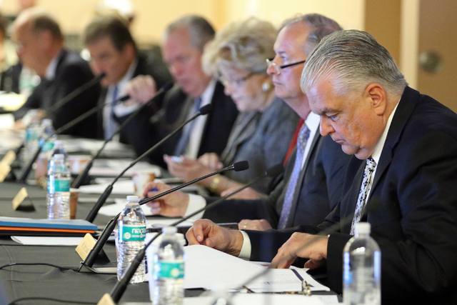 Steve Sisolak, chairman of the Clark County Commission, right, participates in a meeting of the Southern Nevada Tourism Infrastructure Committee at UNLV's Stan Fulton Building Thursday, May 26, 20 ...