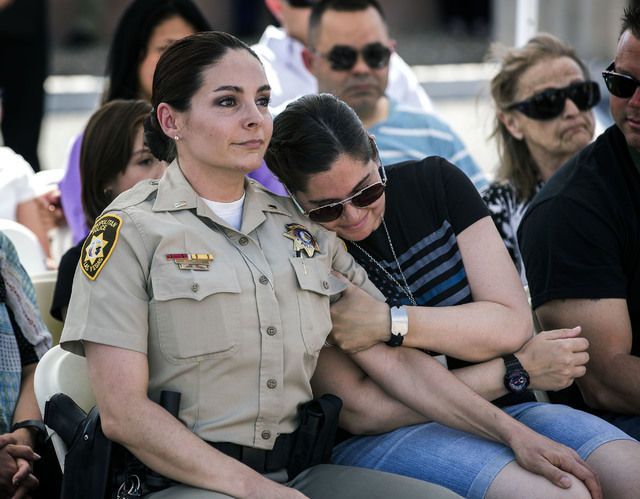 Sabrina Steinmetz, right, police patrol service representative, hugs Metro Lt. Sasha Larkin, during a  ceremony honoring  officers Igor Soldo and Alyn Beck and civilian Joseph Wilcox, who were gun ...