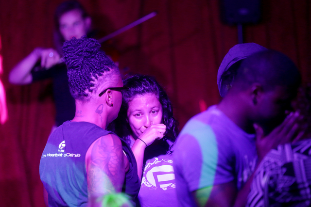 Attendees meet with each other before the start of the fundraiser for Pulse nightclub staff at the gay nightclub Southern Nights on Wednesday, June 15, 2016 in Orlando, Florida. (Rachel Aston/Las  ...