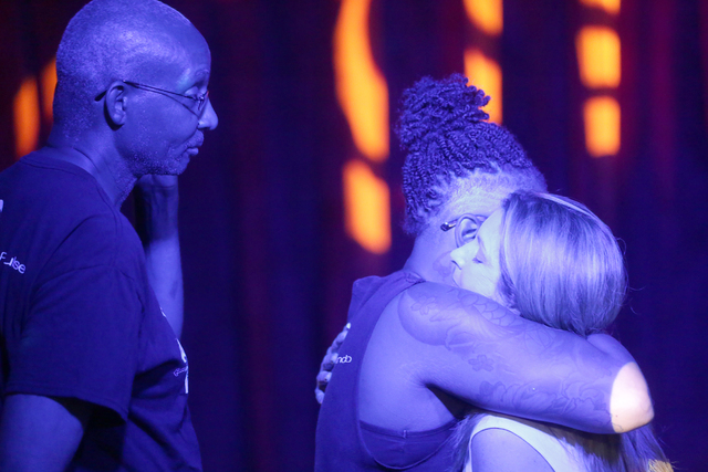 Barbara Poma, far right, the owner of Pulse, hugs staff members before the start of the fundraiser for Pulse nightclub staff at the gay nightclub Southern Nights on Wednesday, June 15, 2016 in Orl ...