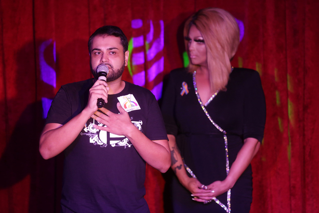 Neema Bahrami, an employee of Pulse who survived Sunday's shooting, speaks to the crowd before the start of the fundraiser for Pulse staff at the gay nightclub Southern Nights on Wednesday, June 1 ...