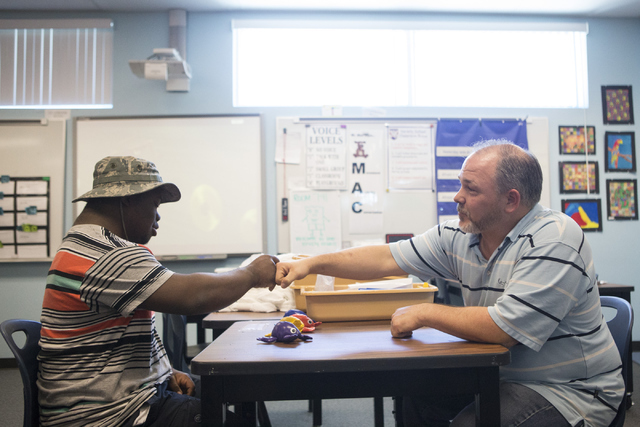 Douglas Trinkle, right, autism teacher at Variety School, works with his student Lee Arnold, 18, at Variety School on Tuesday, May 31, 2016, in Las Vegas. Trinkle was named the Outstanding Educati ...