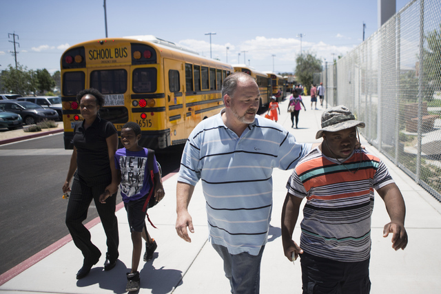 Douglas Trinkle, left, autism teacher at Variety School, walks his student Lee Arnold, 18, to a school bus at Variety School on Tuesday, May 31, 2016, in Las Vegas. Trinkle was named the Outstandi ...