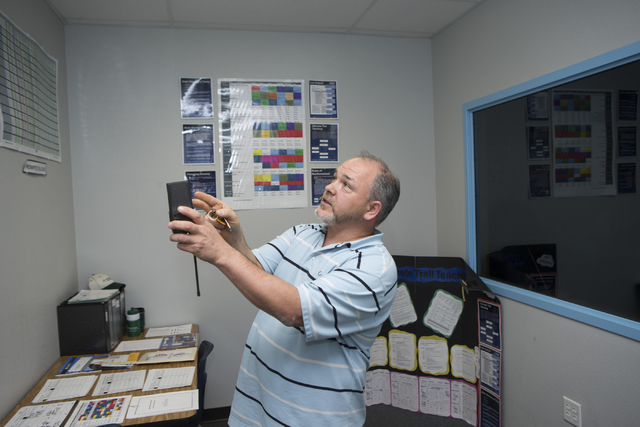 Douglas Trinkle, autism teacher at Variety School, shows recorded behavior logs for his students at Variety School on Tuesday, May 31, 2016, in Las Vegas. Trinkle was named the Outstanding Educati ...