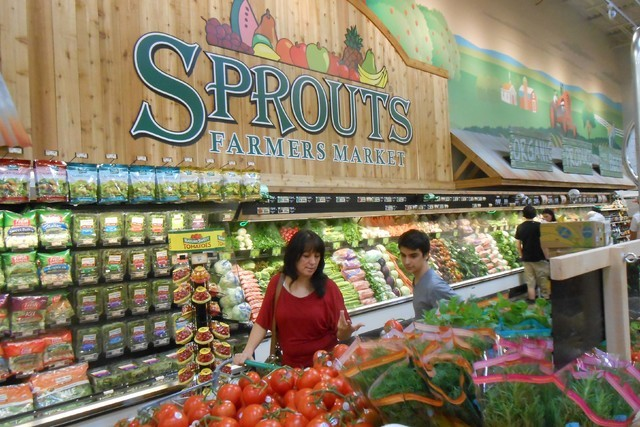 Shoppers look over the produce available at the Sprouts Farmers Market, July 31, 2015, at Sahara Avenue and Hualapai Way. (Jan Hogan/View)