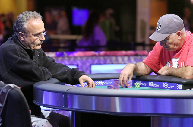 Farhad Davoudzadeh, left, of Palmdale, Calif., and Richard Carr, of Lake Mary, Fla., play in final table of the $565 buy-in Colossus II No-limit Hold'em at the 47th annual World Series of P ...