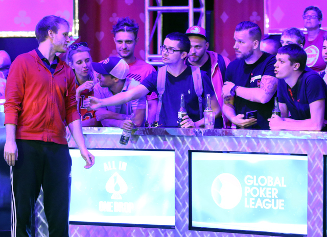 Jiri Horak, left, of Czech Republic, steps away from the final table and meets with supporters during the $565 buy-in Colossus II No-limit Hold'em at the 47th annual World Series of Poker a ...