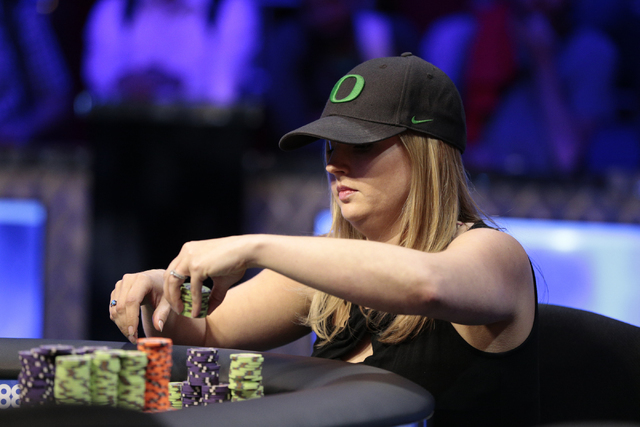 Tournament participant Lisa Meredith stacks her chips during the World Series of Poker $1,500 Millionaire Maker No-Limit Hold'em final table at the Rio Convention Center in Las Vegas on Tuesday, J ...