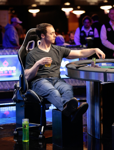 Tournament participant Jason Dewitt places a bet against Garrett Greer's hand as the final two players during the World Series of Poker $1,500 Millionaire Maker No-Limit Hold'em final table at the ...