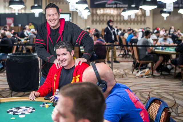 Grant Hinkle stands beside his brother Blair while he  plays $1,500 6-handed No-limit Hold 'em tournament at Rio Convention Center, 3700 W. Flamingo Rd., on Wednesday, June 8, 2016. (Jeff Scheid/L ...