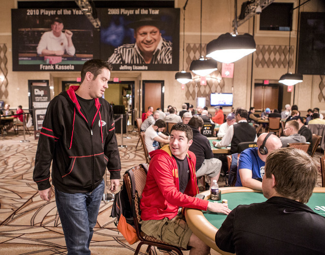 Grant Hinkle, left, talks to his brother Blair while he plays $1,500 6-handed No-limit Hold 'em tournament at Rio Convention Center, 3700 W. Flamingo Rd., on Wednesday, June 8, 2016. (Jeff Scheid/ ...