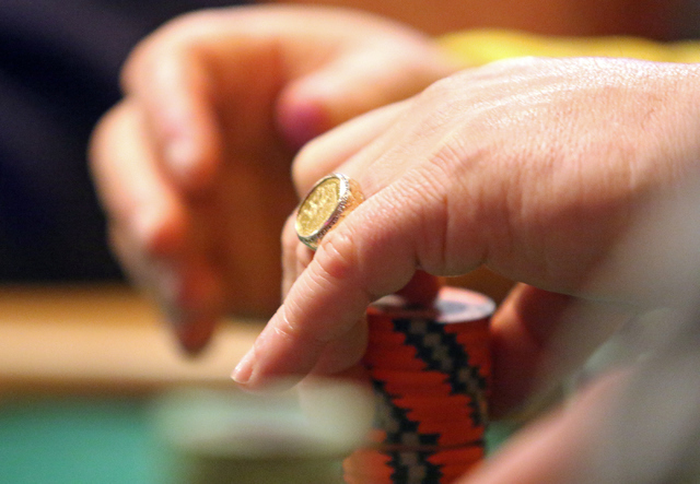 Alan Cutler, of Vernon Hills, Ill., stacks chips while playing in the $1,000 buy-in Seniors No-limit Holdեm at the 47th annual World Series of Poker at the Rio Convention Center Sunday, June ...