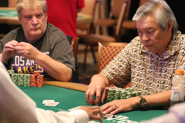 Wesley Chong, right, of Reno, and Joseph Somerville, of Sierra Madre, Calif., play in the $1,000 buy-in Seniors No-limit Hold'em at the 47th annual World Series of Poker at the Rio Conventi ...