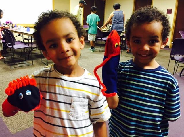 Aaiden and Jaiden Barajic show off superhero sock puppets they made at the Aliante Library, 2400 Deer Springs Way, during the 2015 Summer Reading Program. Special to View