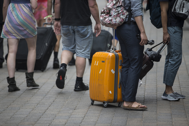 People walk with their luggage at The LINQ on Tuesday, June 21, 2016, in Las Vegas. The Clark County Commission on Tuesday approved a bag ban during New Yearճ Eve, July 4 and other special e ...