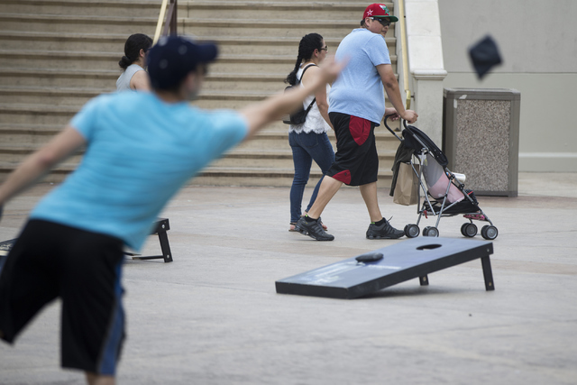 A couple push a stroller near Caesars Palace hotel-casino on Tuesday, June 21, 2016, in Las Vegas. The Clark County Commission on Tuesday approved a bag ban that will also includes strollers durin ...
