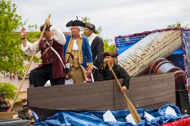 Actors on a float re-enact George Washington's famous 1776 crossing of the Delaware River during Summerlin's Fourth of July parade Saturday, July 4, 2015. (Joshua Dahl/Las Vegas Review-Journal)