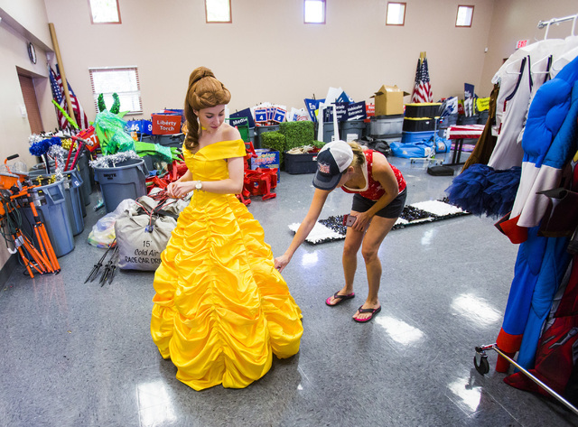 Elizabeth Engle inspects the length of a dress her daughter Madison wears at the Trails Community Center on Monday, June 27, 2016.  Madison Engle will be Belle on a float for the Summerlin Council ...