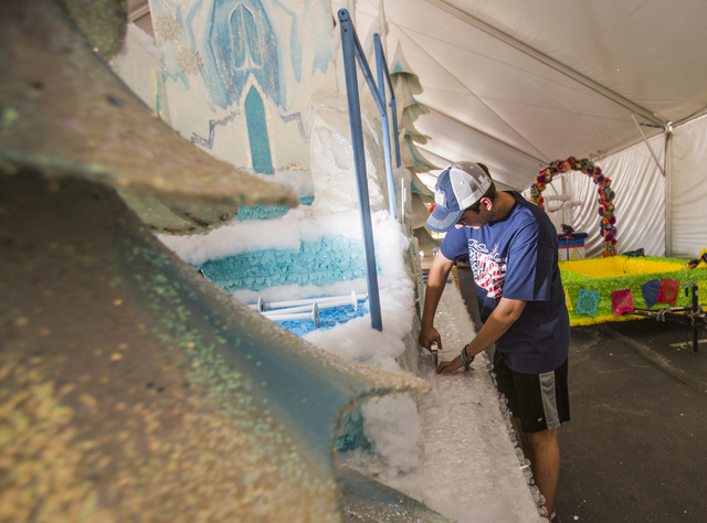 Volunteer Sam Bell works on the Frozen float for the Summerlin Council Patriotic Parade at the Trails Community Center on Monday, June 27, 2016. (Jeff Scheid/Las Vegas Review-Journal) Follow @jlscheid