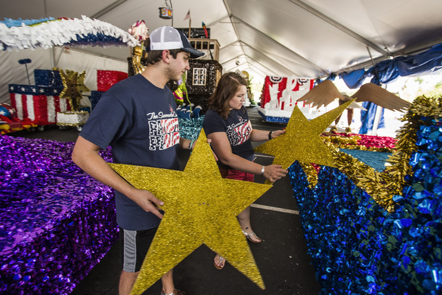 Jennifer Wright, right, a volunteer for 10 years in the Summerlin Council Patriotic Parade, and volunteer Sam Bell inspect star decoration for a float at the Trails Community Center on Monday, Jun ...
