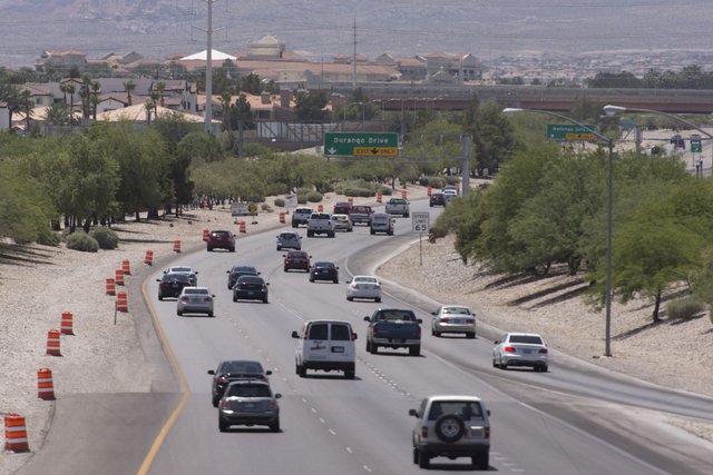 Traffic moves along Summerlin Parkway West of Buffalo Drive as construction takes place for a cable barrier rail system in Las Vegas Tuesday, June 7, 2016. The construction zone stretches from Buf ...