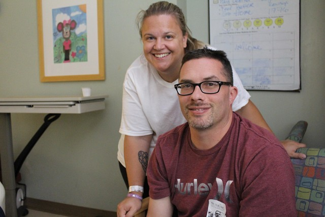 Jessica and Jeff Lokatz pose in a hospital room at Sunrise Children's Hospital. Their 3-year-old daughter, Lilly, is recovering from decompression surgery. Special to View