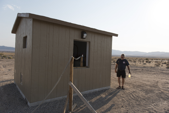 Larry Levy, fire chief with Southern Inyo Fire Protection District, walks around the shed which will house a potable water vending machine in Tecopa, Calif. Tuesday, June 21, 2016. Jason Ogulnik/L ...