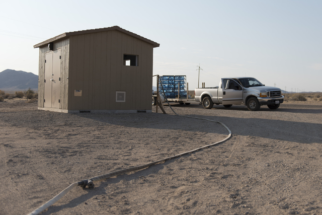 A truck hauling jugs of potable water sits next to the shed which will house a water vending machine and replace the truck delivery method for water to residents in Tecopa, Calif. Tuesday, June 21 ...