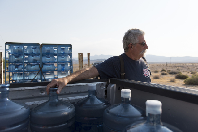 Larry Levy, fire chief with Southern Inyo Fire Protection District, makes his weekly potable water delivery rounds to residents in Tecopa, Calif. Tuesday, June 21, 2016. Jason Ogulnik/Las Vegas Re ...
