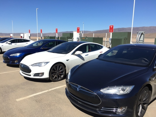 Tesla vehicles parked outside the Tesla Gigafactory east of Reno on Friday, March 18, 2016. (Sean Whaley/Las Vegas Review-Journal Capital Bureau)