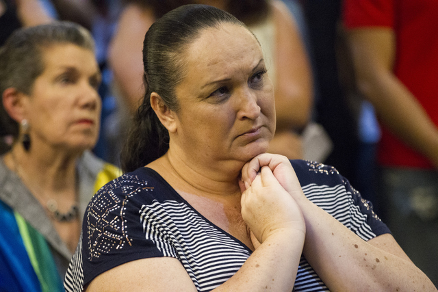 Marlena Goller attends a candle light vigil to honor victims of the Orlando mass shooting at the The Gay and Lesbian Community Center of Southern Nevada on Sunday, June 12, 2016, in Las Vegas. Eri ...