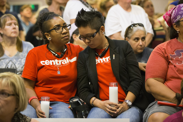 Jennifer White, left, and girlfriend Lady Binayan attend a candle light vigil honoring the victims of the Orlando mass shooting at the The Gay and Lesbian Community Center of Southern Nevada on Su ...